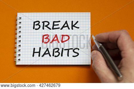 Break Bad Habits Symbol. Businessman Writing Words 'break Bad Habits' On White Note. Beautiful Orang