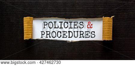 Policies And Procedures Symbol. Words 'policies And Procedures' Appearing Behind Torn Black Paper. B