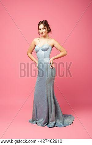 Woman In Silk Dress. Full Length Studio Portrait Of Young Beautiful Woman In Long Gray Silk Dress In
