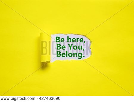 You Belong Here Symbol. Words 'be Here, Be You, Belong' Appearing Behind Torn Yellow Paper. Yellow B