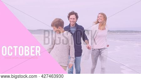 Composition of october and breast cancer text, with smiling family on beach. breast cancer positive awareness campaign concept digitally generated image.