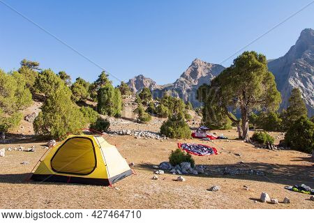 Camping In Moutains. Setting Tents For The Night. Traveling With A Group In Fann Mountains.