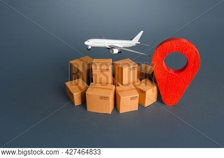 Cargo Plane Over Boxes And Red Pin Geolocation Symbol. Services Of Express Delivery And Transportati