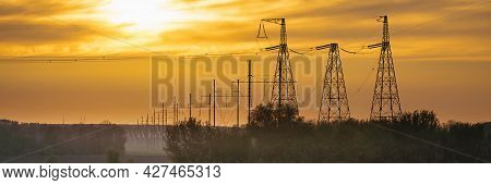 Panorama Wide Of High Voltage Power Line On Industrial Electricity Line Tower. Energy Transmisson Wi