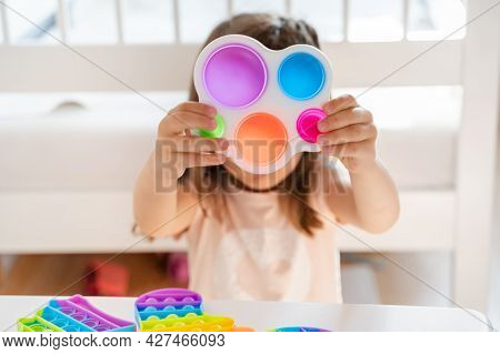 Little Girl,kid,child Plays With Colorful Pop It Children's Room, Bedroom.funny Trendy Silicone Anti