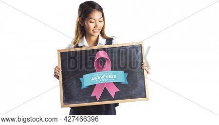 Composition of young smiling woman with pink ribbon logo and breast cancer text on white background. breast cancer positive awareness campaign concept digitally generated image.