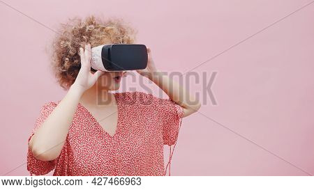 Girl Wearing Virtual Reality Goggles Vr Box Watching A 3d Movie. Feeling Amazed And Completely Lost