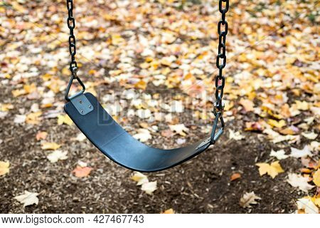 Swing Atthe Playground In The Park In Autumn