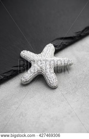 Seed Bead Embroidered Brooch In A Shape Of Starfish On Black Background