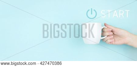 Start Up Business Concept. Power Up Concept. Girl Hand Hold Morning Coffee Cup With Sign Start Icon