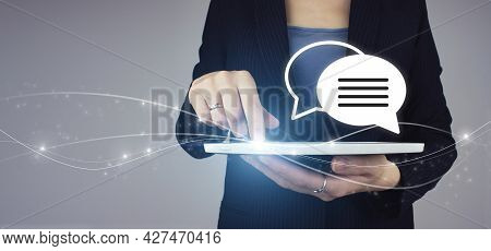 Business Support Concept. Quiestions Online. White Tablet In Businesswoman Hand With Digital Hologra