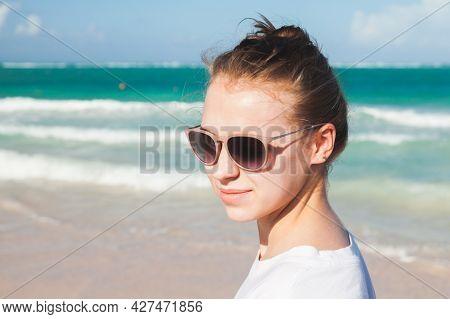 Close Up Outdoor Portrait Of A Beautiful Caucasian Teenage Girl Walking On The Ocean Coast In Domini