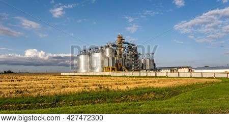 Modern Granary Elevator And Seed Cleaning Line. Silver Silos On Agro-processing And Manufacturing Pl