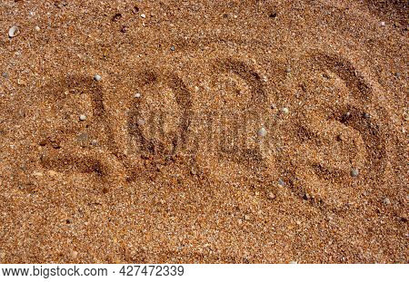 The Numbers 2023 On The Wet Sand. The Concept Of The New Year 2023. Summer Holidays And Sea Trips.
