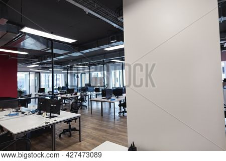 Interior of empty modern office with desks and computers. modern office of a creative design business.