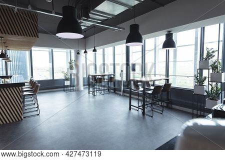 Interior of empty cafeteria with tables in modern office. modern office of a creative design business.