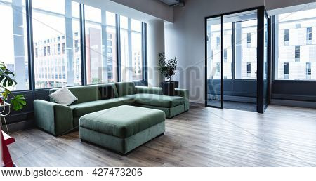 Interior of empty modern office with sofa and windows. modern office of a creative design business.