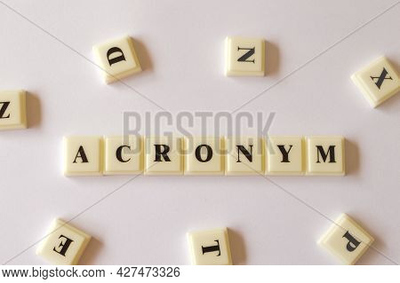 Scrabble Letters With Text Acronym Isolated On White Background