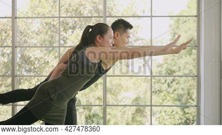 Happy Asian Beautiful Lifestyle Family Couple Doing Yoga Standing Meditating On Virabhadrasana 3 Pos