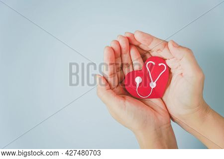 Red Heart Paper Shape With White Stethoscope On Hand, Healthy, Heart Checking, Health Insurance Conc