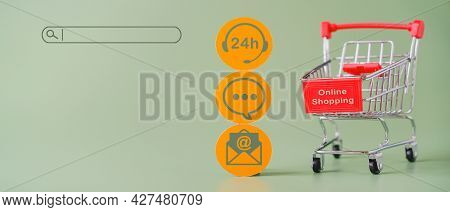 Shopping Cart In Soft Focus With Contact Icon On Round Paper Cut With Search Bar On Green Background