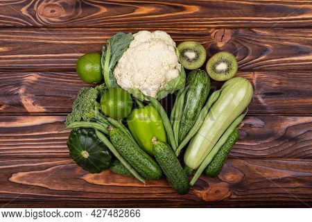 Variety Of Green Vegetables And Fruits. Assortment Of Fresh Vegetables. Set Raw Healthy Food Clean E