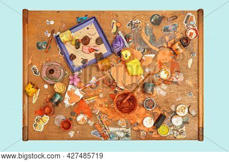 Jars Of Colorful Paints Brushes Plasticine Pieces And Small Toys On Messy Wooden Table In Light Chil