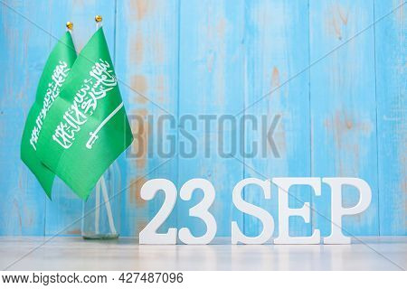 Wooden Text Of September 23rd With Saudi Arabia Flags. September Saudi Arabia National Day And Happy