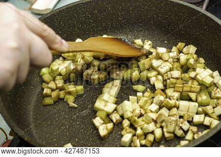 Italian Pasta Farfalle With Eggplant Tomatoes And Green Peas In A Frying Pan Cooking Process Frying