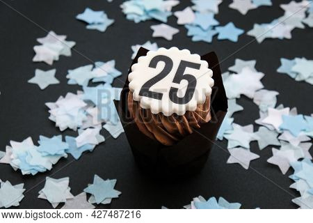 Number 25 On Delicious Chocolate Cupcake With Cream On Dark Background. Muffin. Birthday Cake Party.