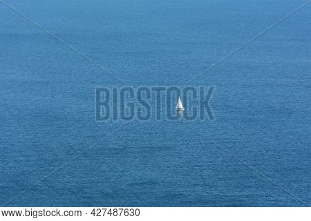 White Sailboat Sea. The Endless Blue Sea, The Concept Of Minimalism, Loneliness, Summer Relaxation.