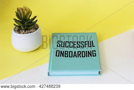 A Symbol Of Successful Adaptation. A Book With The Words Adaptation Success On A White And Yellow Ba