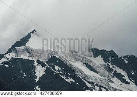 Minimalist Monochrome Atmospheric Mountains Landscape With Big Snowy Mountain Top In Low Clouds. Awe