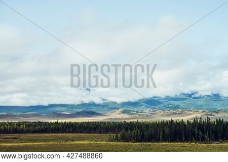 Beautiful Layered Landscape With Hills And Forest In Mountain Valley And Low Clouds In Cloudy Sky. L