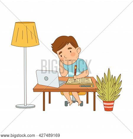 Little Boy At Table In Front Of Laptop Training And Doing Homework As Home Study And Distance Learni