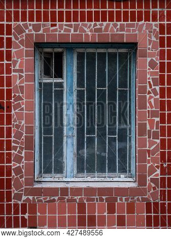 Close-up Of A Textured Old Wooden Window In A Wall With Red Ceramic Tiles On The Wall Of An Old Sovi