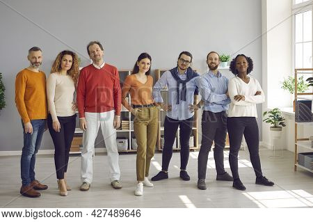 Multiracial Diverse Young Adult People Standing Together In Bright Office