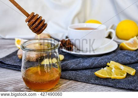Ginger Hot Immunity Boosting Vitamin Natural Drink With Citrus, Honey And Ingredients In A Rustic St