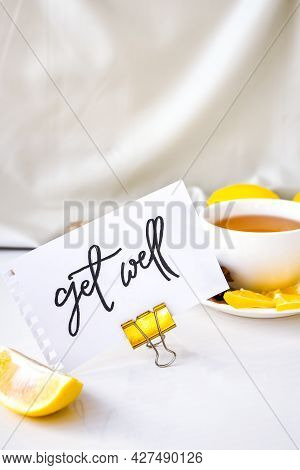 Get Well - Written On Piece Of Paper Among The Products For The Treatment Of Common Cold - Lemon, Gi