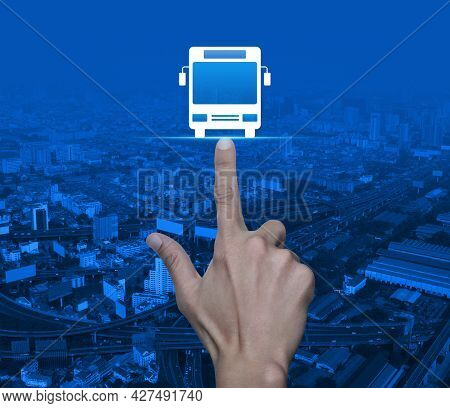 Hand Pressing Bus Flat Icon Over Modern City Tower, Street, Expressway And Skyscraper, Business Tran