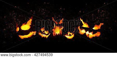Pumpkins With Burning Mouths And Eyes On Blank Black Background. Jack-o-lanterns Decoration.