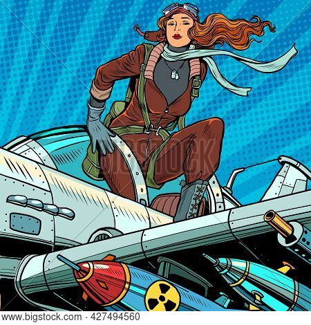 Pin-up Military Pilot. Beautiful Woman In Uniform On A Plane With Bombs And Heavy Weapons