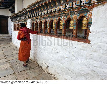Thimpu, Bhutan - May 02, 2019: A Bhutanese Person Rotates The Bells In An Ancient Bhutanese Temple.