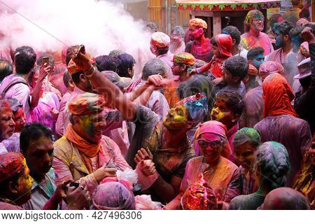 Dwarka, India - March 21, 2019: People Celebrating Holi Festival In India Using Colorful Powder.
