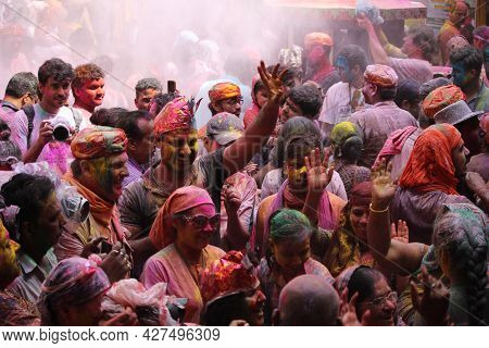 Dwarka, India - March 21, 2019: People Celebrating The Festival Of Colros - Holi In A Temple At Dwar