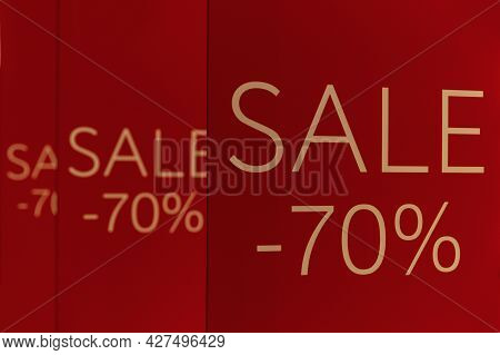 Announcement Of 70% Discounts On Red Banners In The Mall. Close-up. Sale Season.