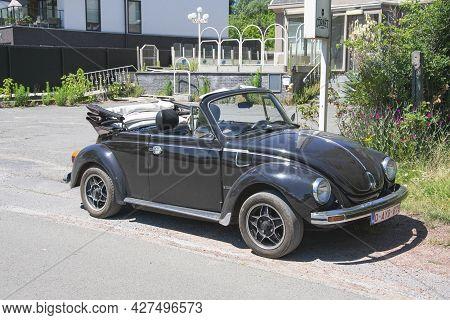 Berlare, Belgium, June 29, 2019, Black Volkswagen Beetle Cabrio Karmann Parked Along The Side Of The