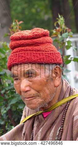 Thimpu, Bhutan - April 30, 2019: A Portrait Of An Elderly Bhutanese Man With Intense Expressions On
