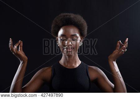 Studio Portrait Of African American Female Model Showing Zen Yoga Mudra Or Okay Sign Gesture. Woman
