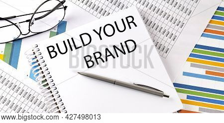 Notebook With Text Build Your Brand . Diagram And White Background,business